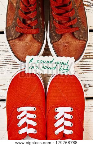 Sport shoes and health proverb. Be active and happy.