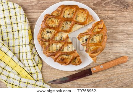 Pieces Of Chicken Pie Stuffed In Plate, Knife And Napkin