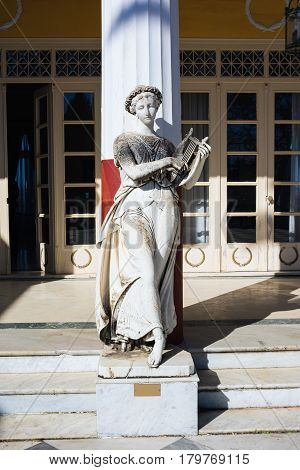 CORFU, GREECE - MARCH 4, 2017: Statue of a Greek mythical muse in Achilleion palace, Corfu Island, Greece, built by Empress of Austria Elisabeth of Bavaria, also known as Sisi.