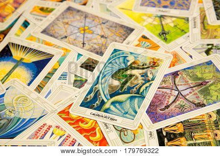 Moscow Russia - December 4 2016: Tarot card Knight of Cups with other cards. Thoth tarot deck. Esoteric background
