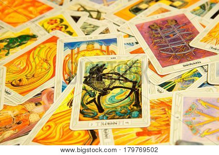 Moscow Russia - December 4 2016: Tarot card Death with other cards. Thoth tarot deck. Esoteric background