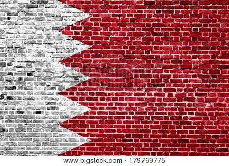 Flag of Bahrain painted on brick wall, background texture