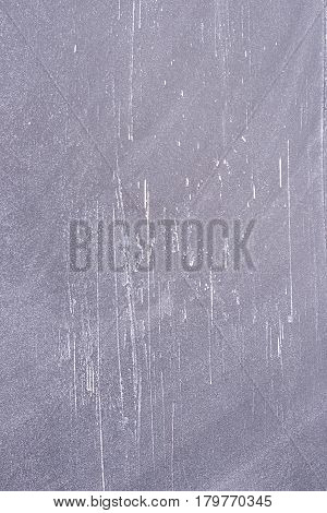 Black school board with scratches. Vertical board