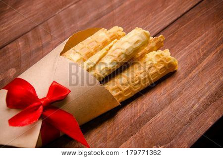 Tubular Wafer. Waffles On Wooden Boards.