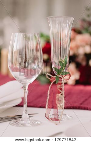 Decorated wedding champagne glasses on the table