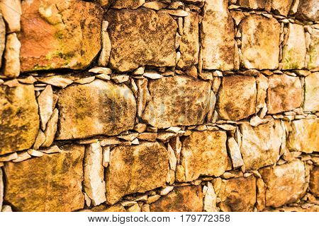 Background of stone wall texture photo. Pile of stones