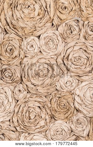 Vertical background paper flowers of different sizes