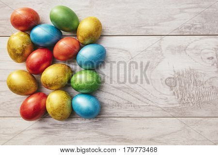 Colorful Easter Holiday Eggs Mother Of Pearl On Wooden Table