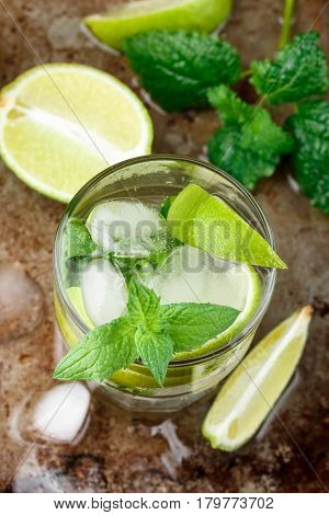 Mojito Cocktail Or Lemonade With Lime, Mint And Ice Cubes. Traditional Summer Refreshing Drink. Sele