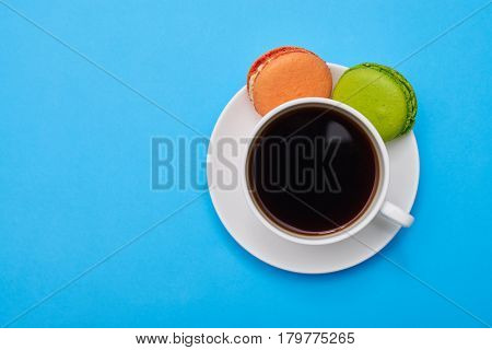 Yummy macaroons with a cup of coffee. Coffee cup with biscuit. Coffee, macaroons a good start of the day