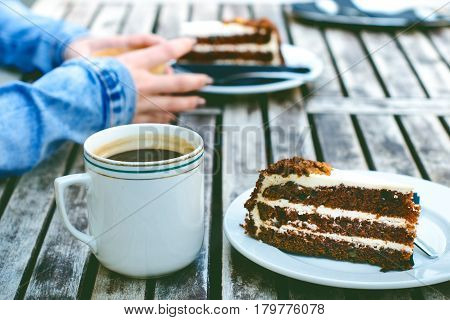 Coffee mug and cake on a wooden vintage table. Hipster concept. Woman drink a coffee. Cups of americano and macchiato.