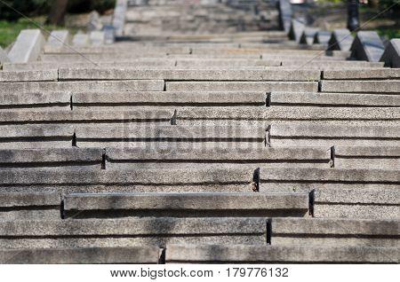 Staircase concrete gray broken in the park