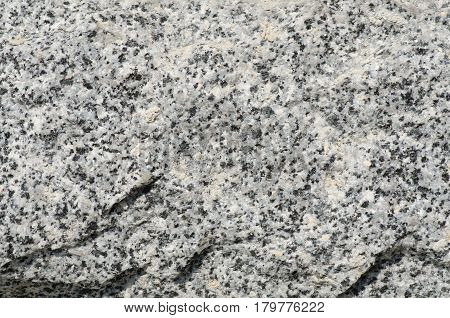 Stone granite in the wall macro photo