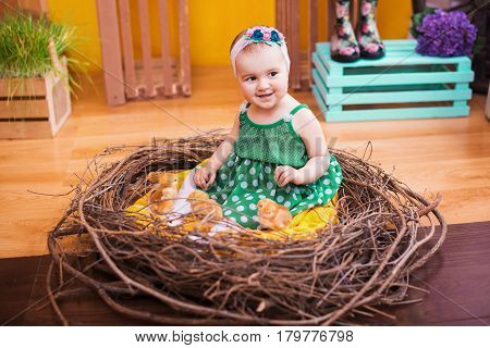 Baby In Easter Nest With Chickens . Easter Holiday Concept: Nest With Sweet Baby