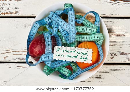Measuring tapes and fruits. Good eating habits.