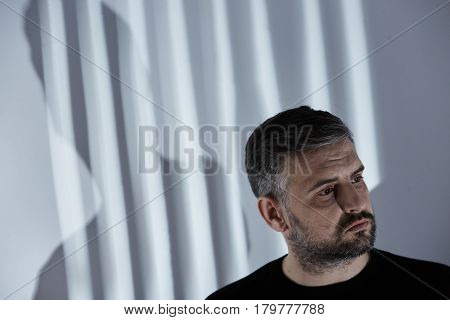 Man Against A Wall With Shadows