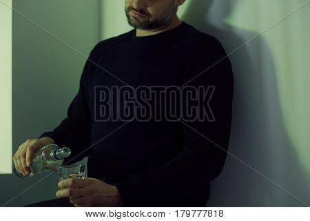Man Pouring Himself Vodka