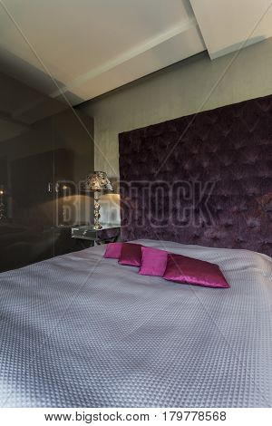 Dark Bedroom With Kingsize Bed
