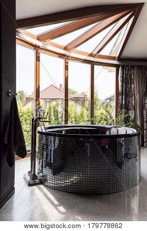 Bathroom With Window Wall And Black Jacuzzi