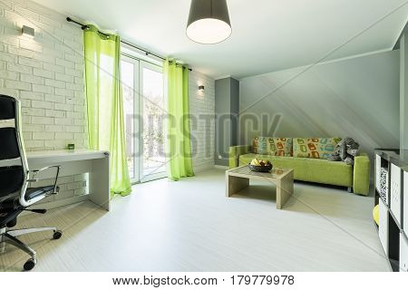 Teenager's Room With Green Sofa