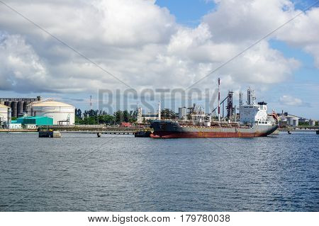 Labuan,Malaysia-Mac 25,2017:Oil & Chemical tanker in petrochemistry dock.Cargo vessel loading of tanker on carrying oil moorage in the Oil and gas industry,refinery factory petrochemical plant in Labuan,Malaysia on 25th Mac 2017.