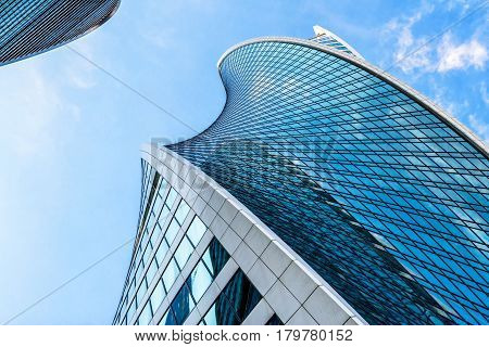 MOSCOW - AUGUST 10, 2016: Low angle view of Moscow-City skyscrapers. Moscow-City (Moscow International Business Center) is a modern commercial buildings with a futuristic design in downtown.