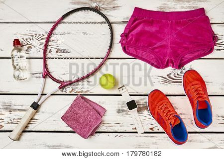 Towel, sneakers, shorts and watch. Discipline leads to result.