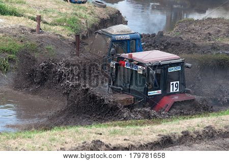 Races of tractors on impassability, Bison-trek-show, Rostov-on-Don, Russia, June 5, 2016