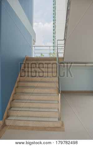 Staircase with a handrail in a buildings.