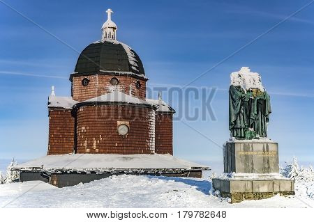 Sculpture Cyril and Methodius church on a background on top of the mountain Radhost in winter