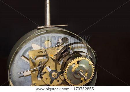 Macro shot of old retro clockwork gears inside the watch. Selective focus