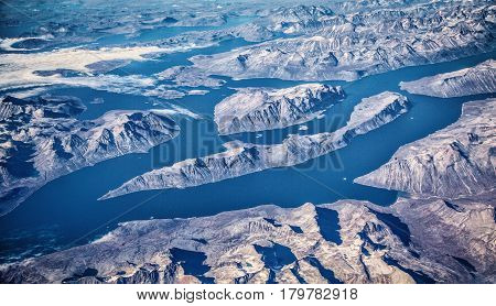 Aerial View Of Greenland With Fjords, Glaciers And Mountains On A Sunny Day