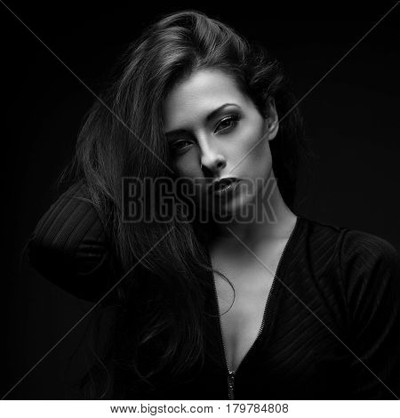 Sexy Calm Glamour Female Model With Long Hair Posing In Black Shirt On Dark Black Background With Re