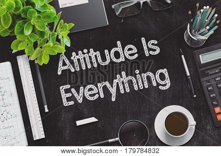 Attitude Is Everything - Black Chalkboard with Hand Drawn Text and Stationery. Top View. 3d Rendering. Toned Image.