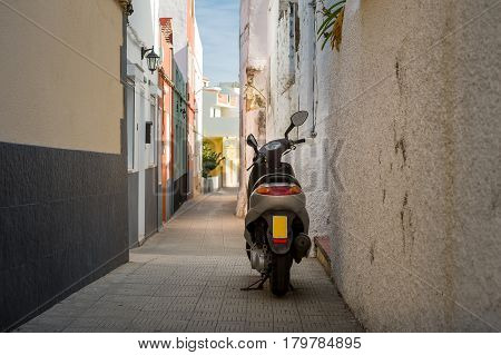 Scooter parked at narrow street of Icod de los Vinos old town. Tenerife, Canary islands, Spain.