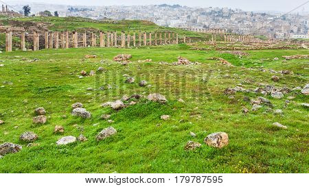 Cardo Maximus Road And Jerash City In Winter