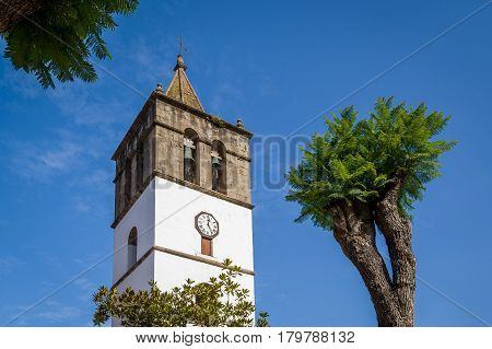 Old tower of Icod de los Vinos with medieval bells and city clock. Icod old town, Tenerife, Spain.