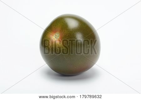Tomate kumato on white background, one item