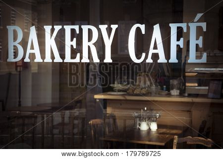 Bakery cafe sign in window of local business