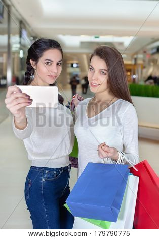 Two Beautiful Girls Makes Selfie In A Shopping Centre