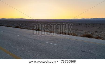 Yellow Sunset And Desert Highway In Jordan