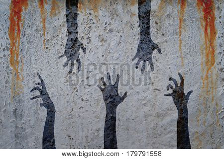 Zombie hands silhouette in shadow on concrete wall and blood background. Zombie theme with corpse hands on cemetery.