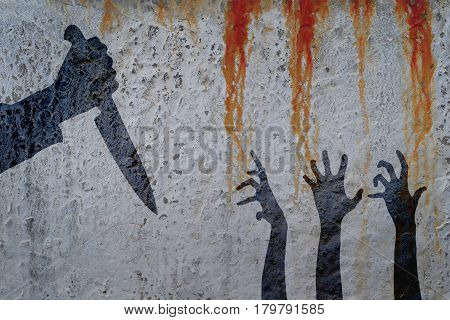 Human hand with knife and Zombie hands silhouette in shadow on concrete wall and blood background. Zombie theme with corpse hands on cemetery.