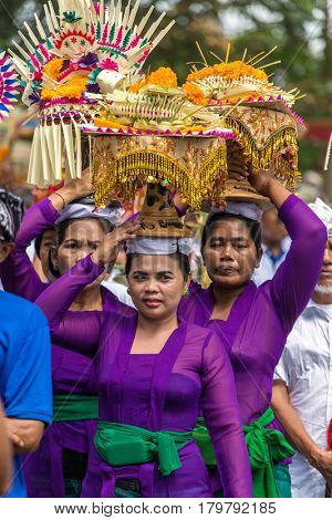 Bali, Indonesia - July 16, 2016: Unidentified balinese women with offerings during ceremony of royal cremation in Ubud, Bali