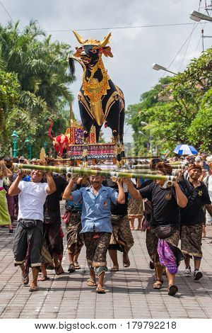 Bali, Indonesia - July 16, 2016: Balinese people participating in royal cremation ceremony in Ubud, Bali.