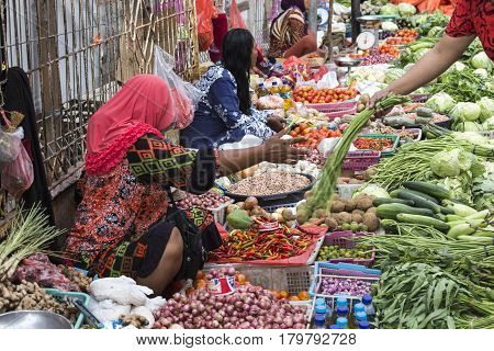 Unidentified Group Of Women Selling Tropical Fruit In The Street