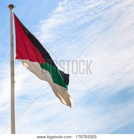 Flag Of The Arab Revolt With Blue Sky In Aqaba
