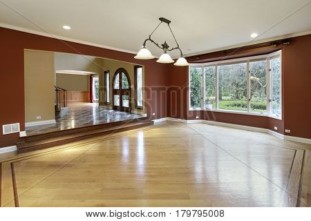 Living room in suburban home with wood floors.