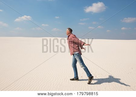 Joyful Man With Open Arms Is Walking Towards The Wind