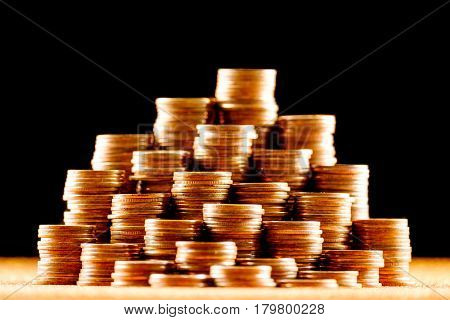 Stacks of golden coins. Financial concept picture